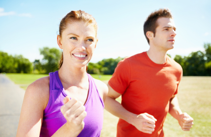 Portrait of couple having fun while jogging outdoors